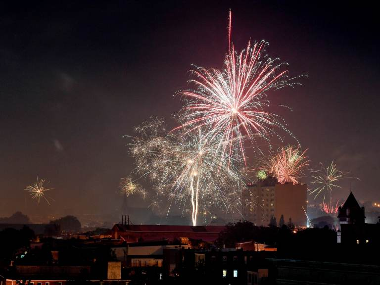 People set off consumer aerial fireworks in the City of Reading