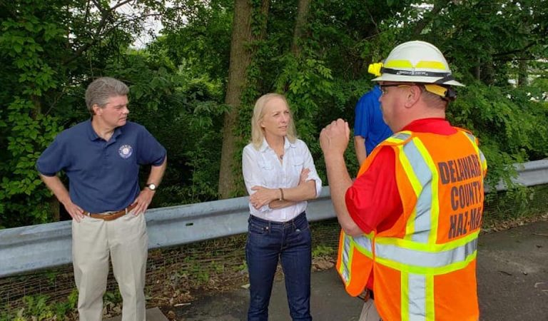 EMS and elected officials monitor the site of an oil spill in Delco
