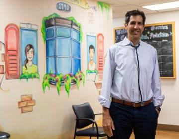 Dr. Eric Berger stands inside his Center City Pediatrics office