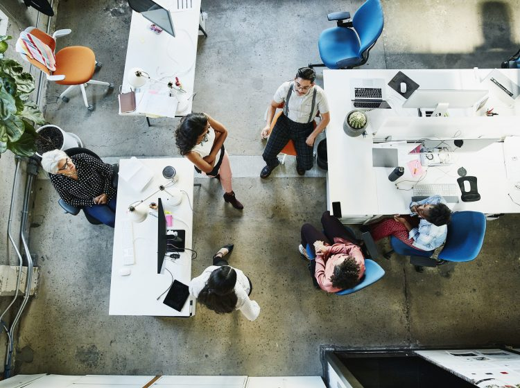 Overhead view of design team having project meeting in office