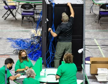 Contractors examine and recount ballots from the 2020 general election