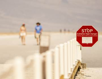 A sign warns of extreme heat danger last week at the Badwater Basin in Death Valley, Calif. (Kyle Grillot/Bloomberg via Getty Images)