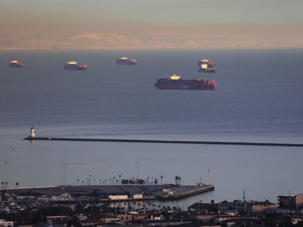 Container ships and tankers are anchored close to the ports of Los Angeles and Long Beach