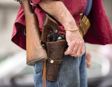 A closeup of a protester's open carry gun