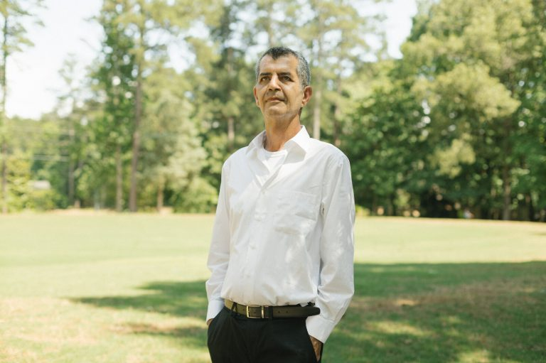 Mehran Mossaddad stands in a park