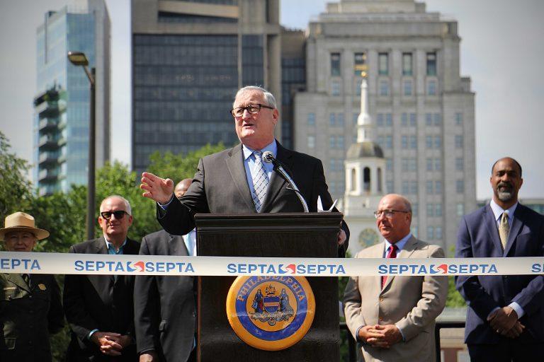 Philadelphia Mayor Jim Kenney speaks from behind a podium
