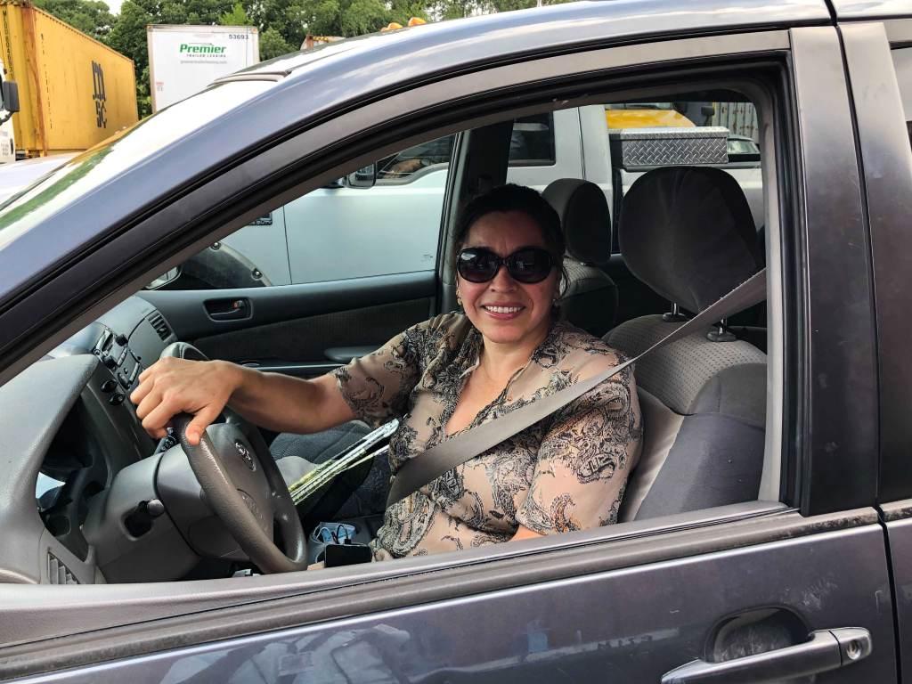 Estrella Sanchez sits inside her car