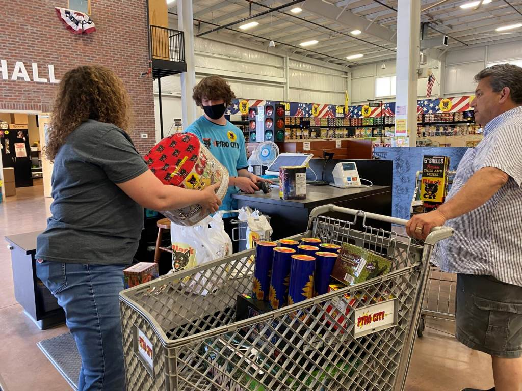 Donna Nuccio helps a customer at a Pyro City store