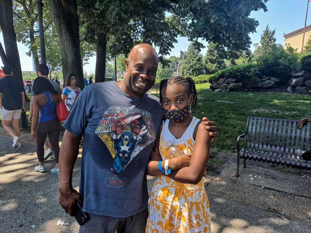 Obie Hazzard stands with his daughter Justice
