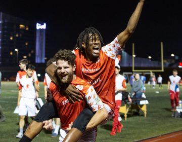 Veteran Phoenix Eric Witmer picks up newbie Phoenix player Nate Little in celebration after their 21-16 win over the Tampa Bay Cannons at the South Philadelphia SuperSite, June 4th 2021. (Emily Cohen for Billy Penn)