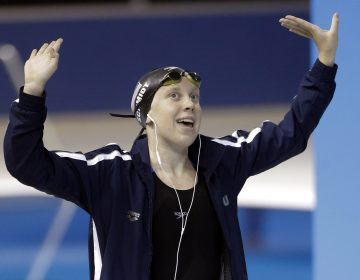 Sierra Schmidt of the United States dances before the start of the women's 800 meter freestyle swimming event at the Pan Am Games Saturday, July 18, 2015, in Toronto. Schmidt won the gold medal in the event. (AP Photo/Mark Humphrey)