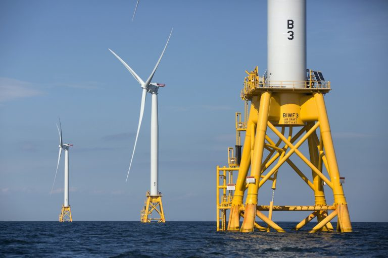 Three of Deepwater Wind's five turbines stand in the water off Block Island
