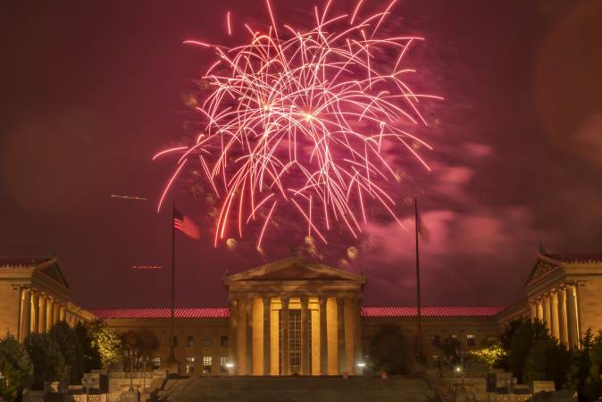 Fireworks erupt over the Philadelphia Museum of Art. The display brought to a close the city's Welcome America celebration. (Jonathan Wilson for WHYY)