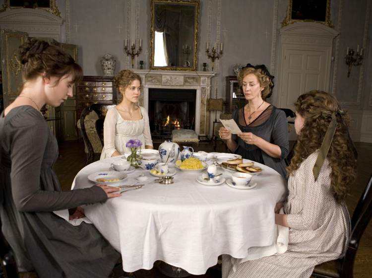 Hattie Morahan (as Elinor Dashwood), Charity Wakefield (as Marianne Dashwood), Lucy Boynton (as Margaret Dashwood), and Hanet McTeer as Mrs. Dashwood gathered around a table in Sense and Sensibility