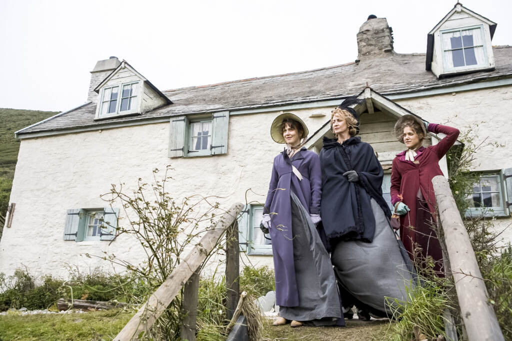 Hattie Morahan (as Elinor Dashwood), Charity Wakefield (as Marianne Dashwood), and and Hanet McTeer as Mrs. Dashwood standing outside their house in Sense and Sensibility