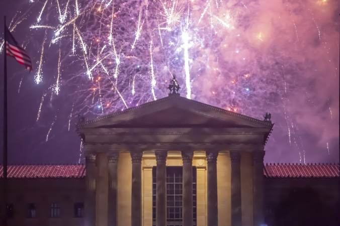 Fireworks cascade behind the central portico of the Philadelphia Museum of Art. (Jonathan Wilson for WHYY)