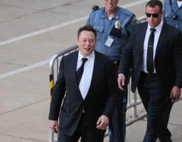 Tesla founder Elon Musk leaves the New Castle County Courthouse