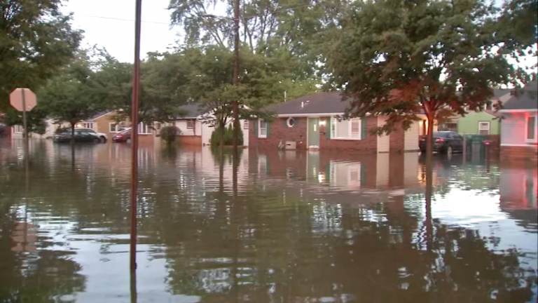 Houses are pictured amid heavy floodwaters.