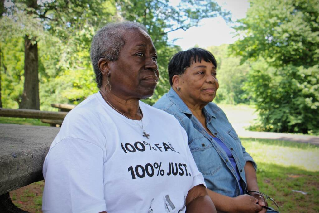 Frances Upshaw (left) and Paula Paul share a bench in Fernhill Park