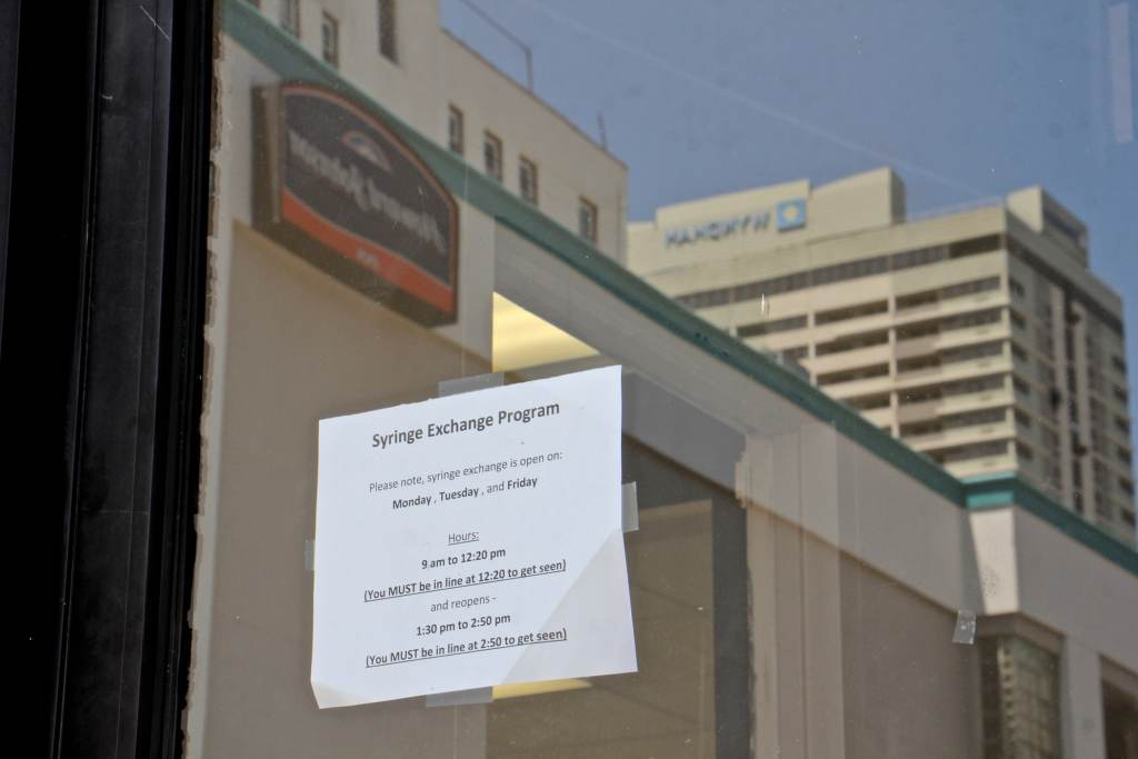Wyndam and Howard Johnson hotels loom over the Oasis storefront in Atlantic City