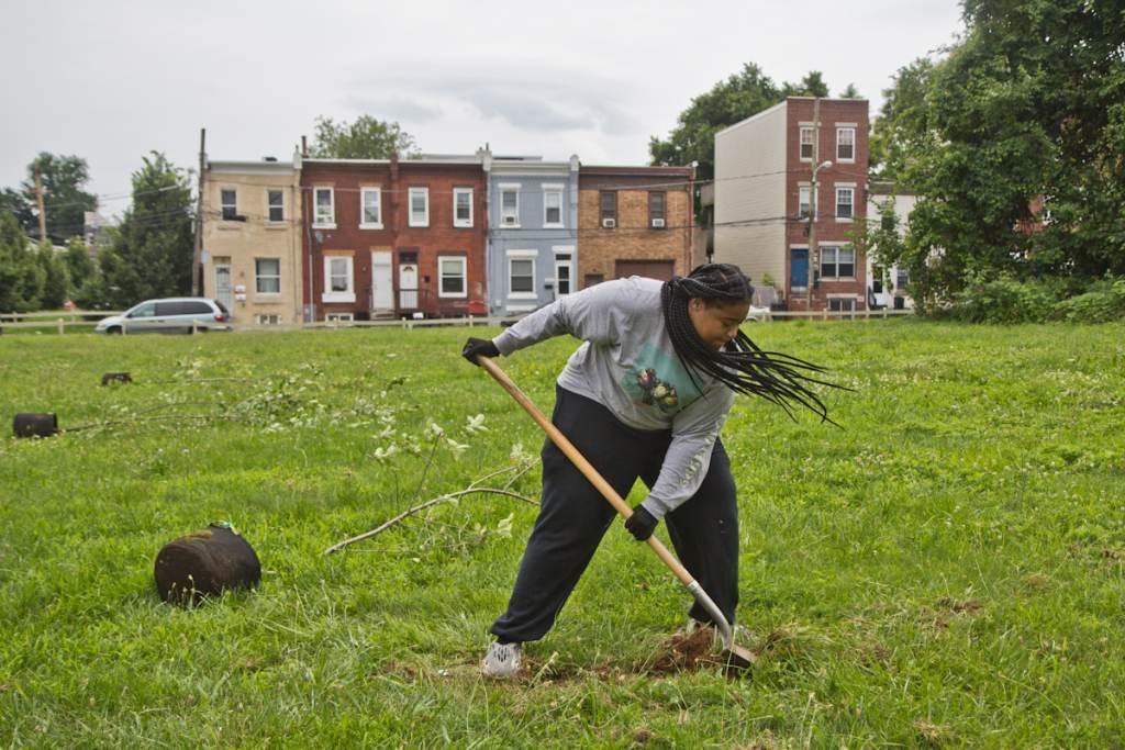 Brandy Fortune plants a tree in North Philadelphia