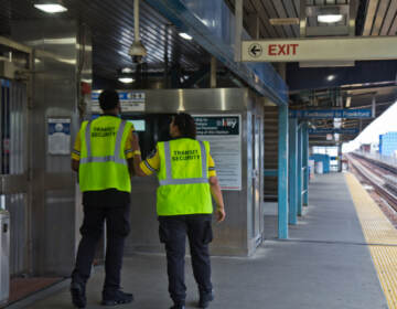 Transit security officers work on the platform of the Girard stop