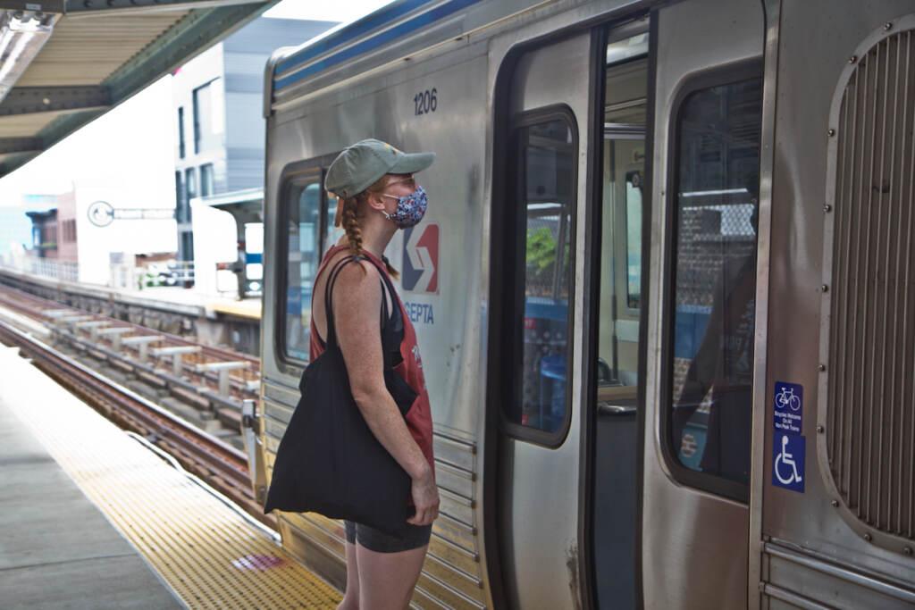 Ruby Tumaz boards a Market-Frankford Line train