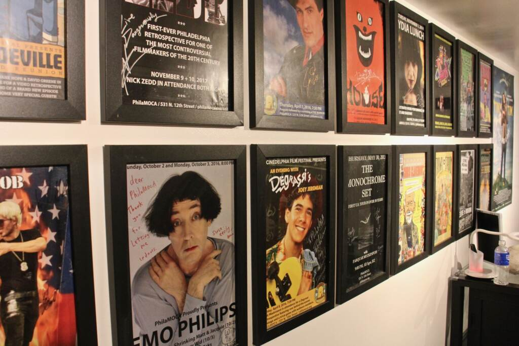 A closeup of posters on the wall