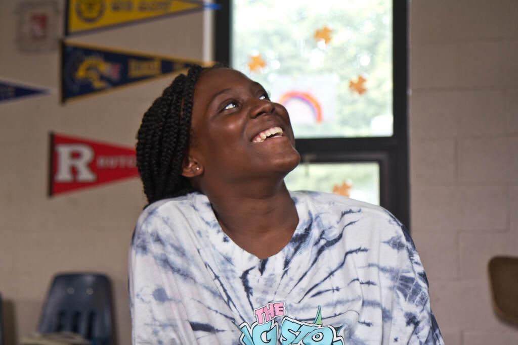 Monyria Harvey smiles while looking upward