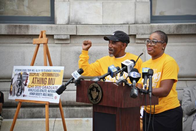 Al Jennings and Bernice Mitchell speak from a podium at Trenton City Hall
