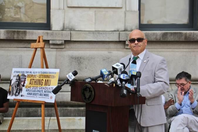 Trenton Mayor Reed Gusciora speaks from a podium