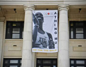 A banner celebrating Olympic track star Athing Mu hands on the front of Trenton City Hall.