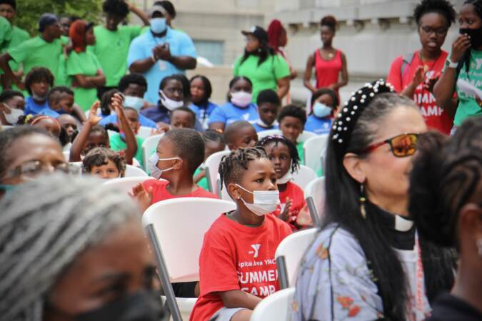 Young YMCA campers attend a celebration of Olympic athlete Athing Mu at Trenton City Hall