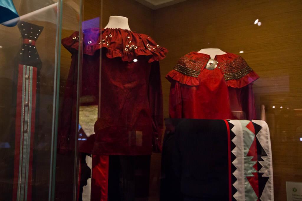 A contemporary Lenape Pow Wow dress (left) and a similar dress for a celebration