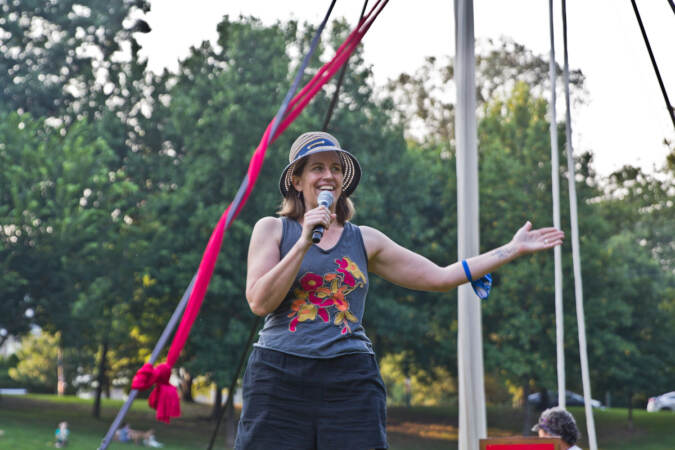Kittson O'Neill speaks into a microphone during a Shakespeare in Clark Park event