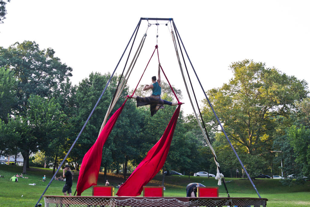 Kaitlin Chin performs aerials in a Shakespeare in Clark Park production
