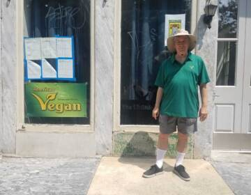 Vance Lehmkuhl stands outside the American Vegan Society space on 2nd Street