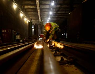 A file photo shows a SEPTA worker repairing a trolley track during a cleaning blitz. (SEPTA)
