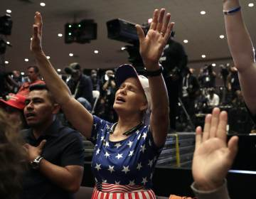 Wanda Albritton, of Miami Springs, Fla., raises her ams in prayer during a rally for evangelical supporters at the King Jesus International Ministry church, Friday, Jan. 3, 2020, in Miami. (AP Photo/Lynne Sladky)