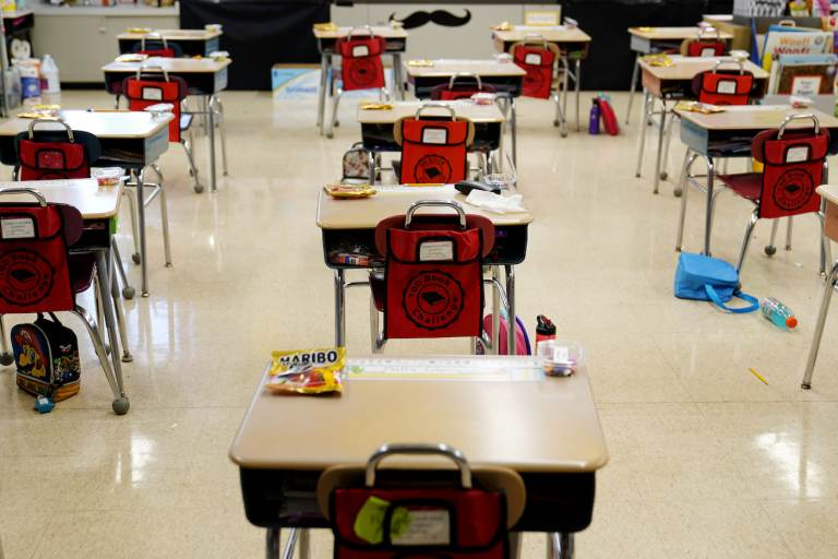 In this Thursday, March 11, 2021 file photo, desks are arranged in a classroom at an elementary school. (AP Photo/Matt Slocum, File)