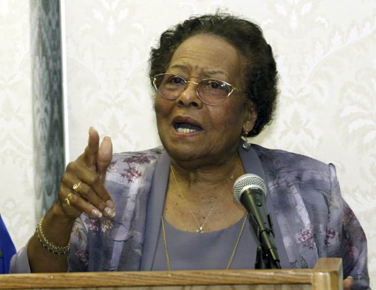 Gwendolyn Faison speaks from a podium