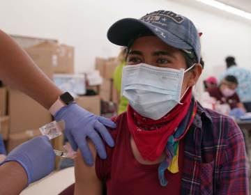 Guadelupe Gracia Munoz receives the Johnson and Johnson COVID-19 vaccine