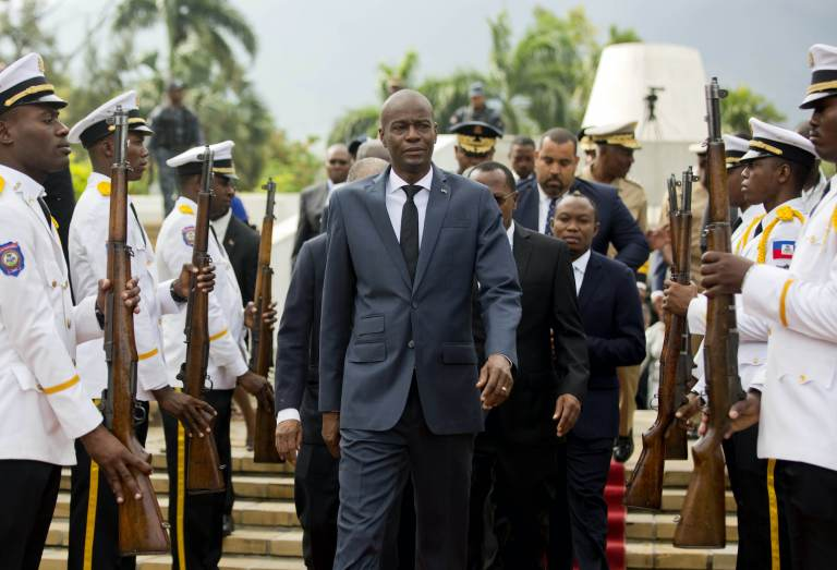 Haiti's President Jovenel Moise exist a museum with armed people flanked on both sides