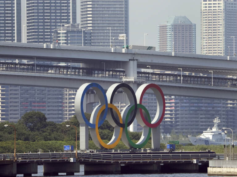 The Olympic rings float on a barge ahead of the 2020 Summer Olympics