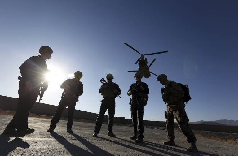 FILE - In this Nov. 30, 2017, file photo, American soldiers wait on the tarmac in Logar province, Afghanistan. (AP Photo/Rahmat Gul, File)