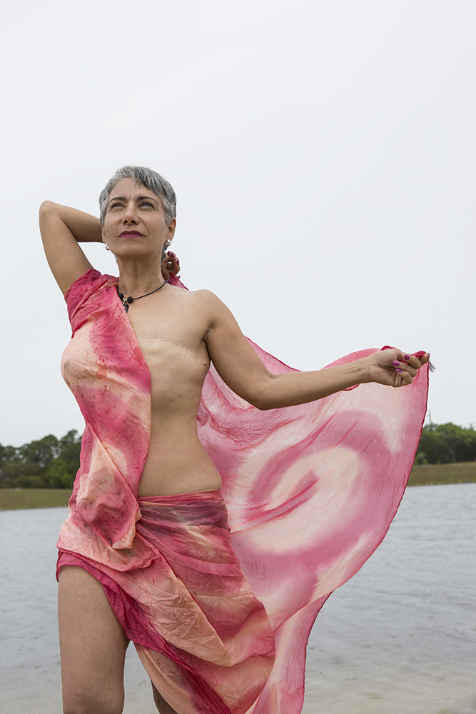 A breast cancer patient is pictured wearing a wrap, evoking a goddess