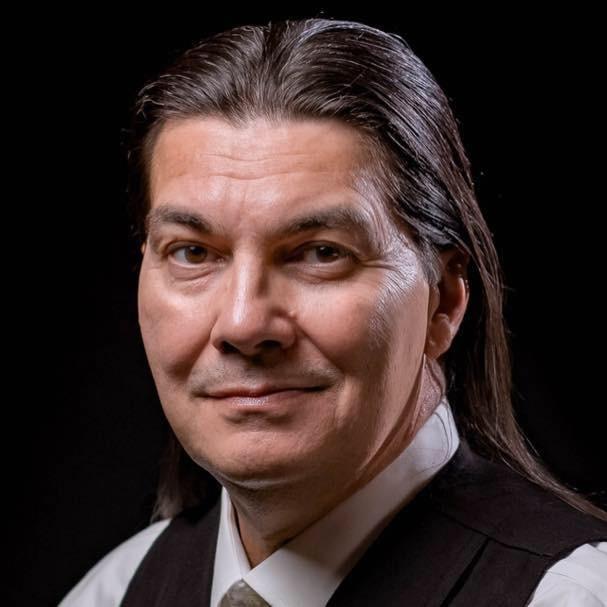 A headshot of Curtis Zunigha