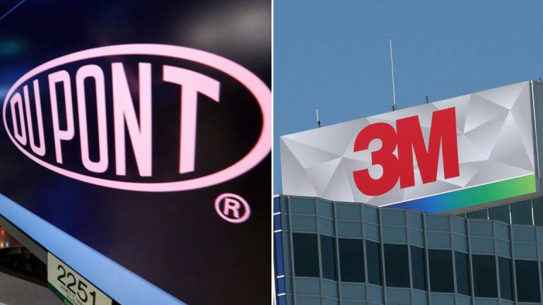 DuPont and 3M are among the companies being sued. (AP Photo/Richard Drew, File; AP Photo/Jim Mone)