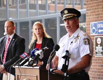 Philadelphia police Chief Inspector Frank Vanore (right) joins acting U.S. Attorney Jennifer Arbittier Williams and FBI Assistant Special Agent in Charge James Christie to announce federal murder-for-hire and weapons charges against Darnell Jackson, 47, of Philadelphia. (Emma Lee/WHYY)