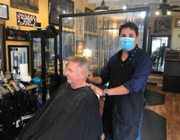 Diego Rivera cuts Michael Kane's hair